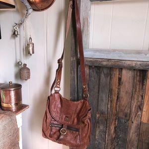 Brown vintage lucky brand cross body bag.